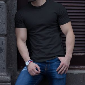 buff-man-wearing-a-t-shirt-mockup-while-lying-against-a-wall-a17659